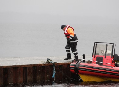 A member of the Civil Defence returns to shore during the search