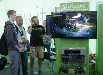 A group of men play the Xbox One games at the Game Developers Conference 2014 in San Francisco.