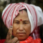 A Mishing tribal woman displays her indelible ink mark on her finger after casting her vote, Assam state, India (AP Photo/Anupam Nath)<span class=