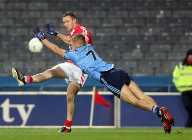 Cork's John Hayes and Dublin's Johnny Cooper.