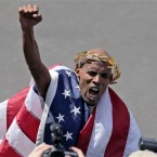 Meb Keflezighi celebrates his win<span class=