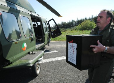 Pilot Terry Gaff loading up a ballot box after the Fiscal Treaty Referendum on Tory Island in May 2012.