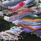 Colourful carp streamers flutter in the air over the Sagami River in Sagamihara, west of Tokyo, to mark national Children's Day.<span class=
