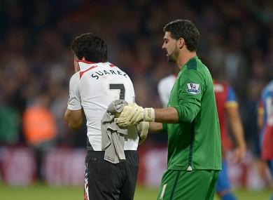 Luis Suarez and Crystal Palace goalkeeper Julian Speroni.