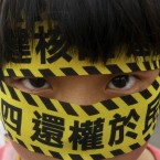 A Taiwanese boy wears a slogan reading