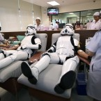 Udomsak Ratanotayo, left, and Suttinan Boonsomkiat wear storm trooper costumes while donating blood at the Thai Red Cross in Bangkok, Thailand.<span class=