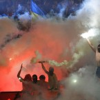 Shakhtar Donetsk fans wave Ukrainian flags during the final soccer match of Ukraine's Cup.<span class=