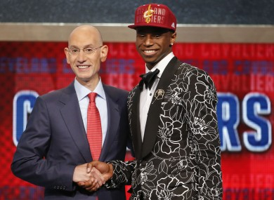 NBA Commissioner Adam Silver, left, congratulates Andrew Wiggins of Kansas.