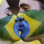 Brazilian soccer team supporters kiss before the World Cup match between Brazil and Chile at the Mineirao Stadium in Belo Horizonte. <span class=
