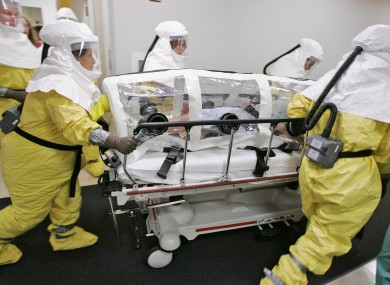 File photo: An actor-patient, made up to look as if he is infected with smallpox, is wheeled in an isolation pod during a drill at the Nebraska biocontainment unit in October 2006.