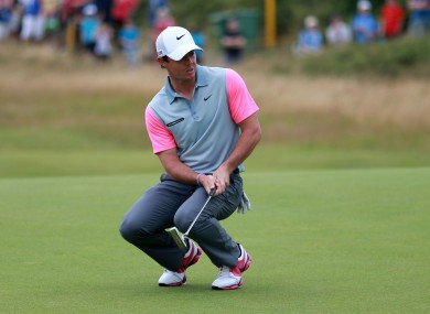 McIlroy reacts to a putt on the 11th during day four of the 2014 Open Championship.