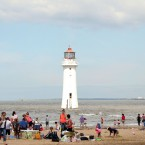 People enjoy more hot weather on the beach in New Brighton.<span class=