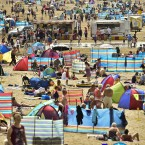 Holiday makers enjoy sunny beach weather at Woolacombe beach, North Devon, as the hot weather continues across the UK.<span class=