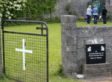 Members of the public pay their respects at the grounds where the unmarked mass grave containing the remains of nearly 800 infants.