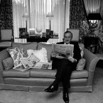 Reynolds reading the newspapers at his Dublin home after he was sacked by Taoiseach Charles Haughey from his job as Finance Minister.