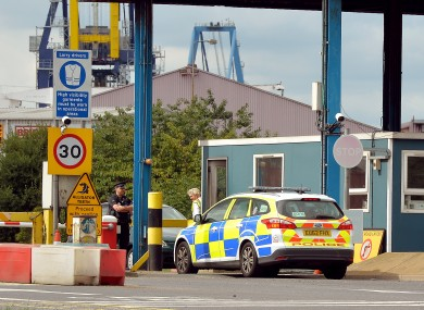 A police car arrives at the main entrance to Tilbury Docks in Essex.