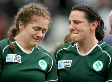 Coghlan and Paula Fitzpatrick react after defeat to France in the World Cup.