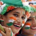 Schoolgirls dressed in the colors of the Indian national tricolor flag participate in rehearsals for Independence Day celebrations in Ajmer, India.<span class=