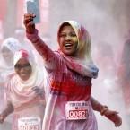 A participant takes a selfie as she runs through a
