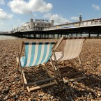 Two lone deckchairs stand on a near deserted Brighton beach as the effects of ex-Hurricane Bertha are felt across England and Wales.<span class=