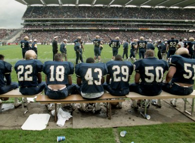 The Navy bench looking on.
