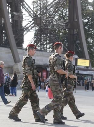 Soldiers patrol at the Eiffel Tower in Paris.