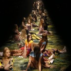 Models sit on the catwalk during Dries van Noten's Spring/Summer 2015 ready-to-wear fashion collection presented in Paris, France.<span class=