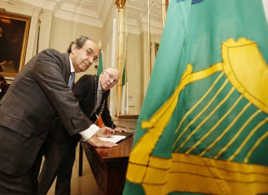 Abdelrazek signing the Book of Condolences for Gaza victims in the Mansion House.