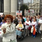 Chairperson Survivors of Symphysiotomy, Marie O'Connor with survivors outside Government Buildings.