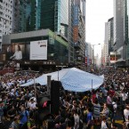 Residents and pro-Beijing supporters surround a pro-democracy activist tent.<span class=