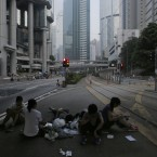 A protester sit in a main road at the financial district in Hong Kong.<span class=