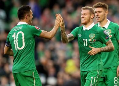 Robbie Keane and James McClean celebrate an Ireland goal.