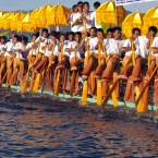 Ethnic Inntha people row a long boat by legs as they celebrate the annual Paung-Daw -Oo pagoda festival in Inlay Lake, Southern Shan State, Myanmar.<span class=
