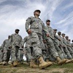 New Jersey National Guard troops march as they pass in review during the New Jersey National Guard's annual Military Review. <span class=