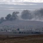 Smoke from a fire rises following a strike in Kobani.<span class=