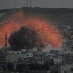 An explosion following an air strike in Kobani.<span class=