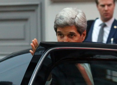 U.S. Secretary of State John Kerry leaves Palais Coburg where closed-door nuclear talks with Iran take place in Vienna.