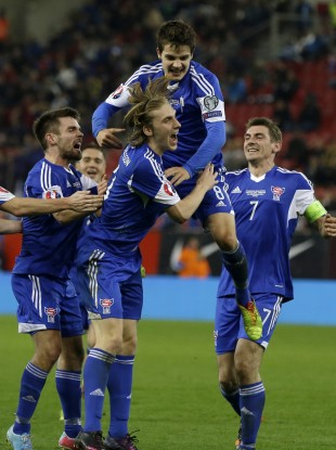 Faroe Islands players celebrate their opening goal against Greece.