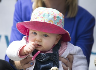 A baby pictured at a medical card protest outside Government Buildings in May.
