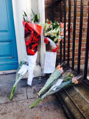 Flowers at the spot where Jonathan Corrie was found dead yesterday morning.
