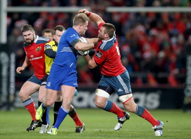 CJ Stander attempts to bring down Luke Fitzgerald at Thomond Park.
