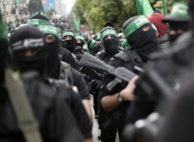 Palestinian Hamas masked gunmen display their military skills during a rally to commemorate the 27th anniversary of the Hamas militant group earlier this week.