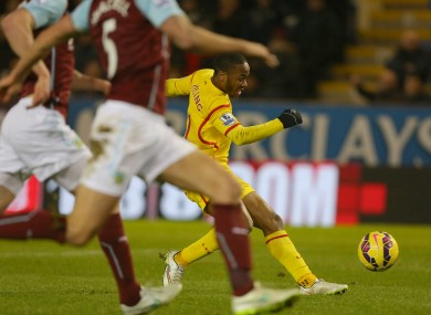 Liverpool's Raheem Sterling scores during the Barclays Premier League match at Turf Moor.