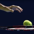 Roger Federer of Switzerland prepares for a serve to Andreas Seppi of Italy during their third round match at the Australian Open tennis championship in Melbourne, Australia, Friday, Jan. 23, 2015. <span class=