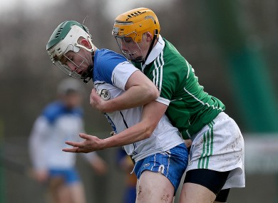 Colin Dunford of Waterford tussles with Limerick's Adrian Breen this afternoon in Kilmallock.