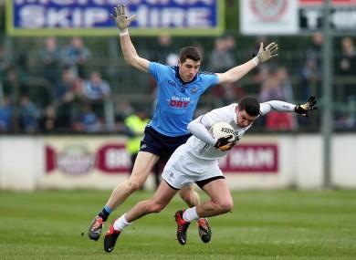 Emmett O'Conghaille of Dublin goes up against Eamon Callaghan of Kildare.