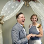Rebekah Monson, left, 34, and her partner of nine years, Andrea Vigil, right, 37, participate in a wedding ceremony at the marriage license bureau in Miami. Miami-Dade Circuit Judge Sarah Zabel presided over Florida's first legally recognized same-sex marriages Monday afternoon. Still, most counties held off on official ceremonies until early Tuesday, when U.S. District Judge Robert L. Hinkle's ruling that Florida's same-sex marriage ban is unconstitutional took effect in all 67 counties. (AP Photo/Wilfredo Lee)<span class=