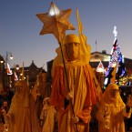 People parade through the streets as part of celebrations of Three Kings Day in downtown Vilnius, Lithuania. Epiphany, the 12th night of Christmas, marks the day the three wise men visited Christ. (AP Photo/Mindaugas Kulbis)<span class=