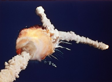 1986 file photo, the space shuttle Challenger explodes shortly after lifting off from the Kennedy Space Center in Cape Canaveral.