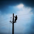ESB worker Shane McGowan works on a telegraph pole in the area of Drumcliffe, Co. Sligo, Thursday January 15, 2015. A fierce storm crashing into Ireland from the Atlantic has left thousands of homes without power, grounded flights, halted ferry crossings and delayed countless rail and road commuters.<span class=